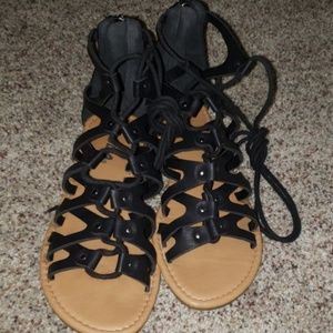 Black gladiator lace up sandals by Soda